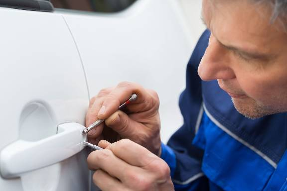 locksmith is working on car lockout for customer - The 247 Locksmith